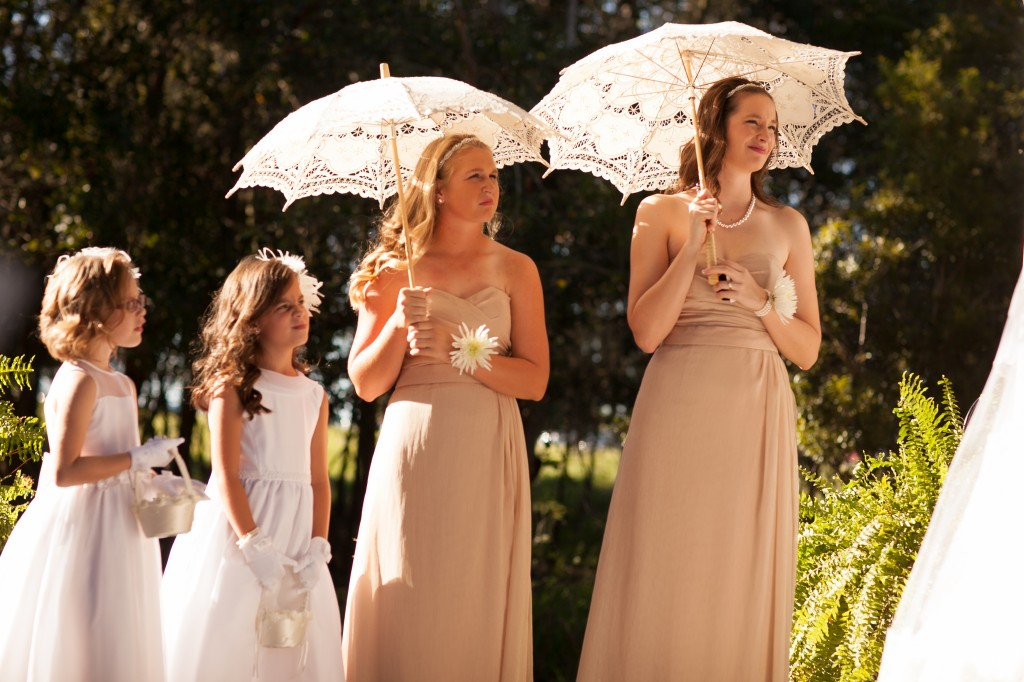 Cute umbrellas keep the bridesmaids cool.