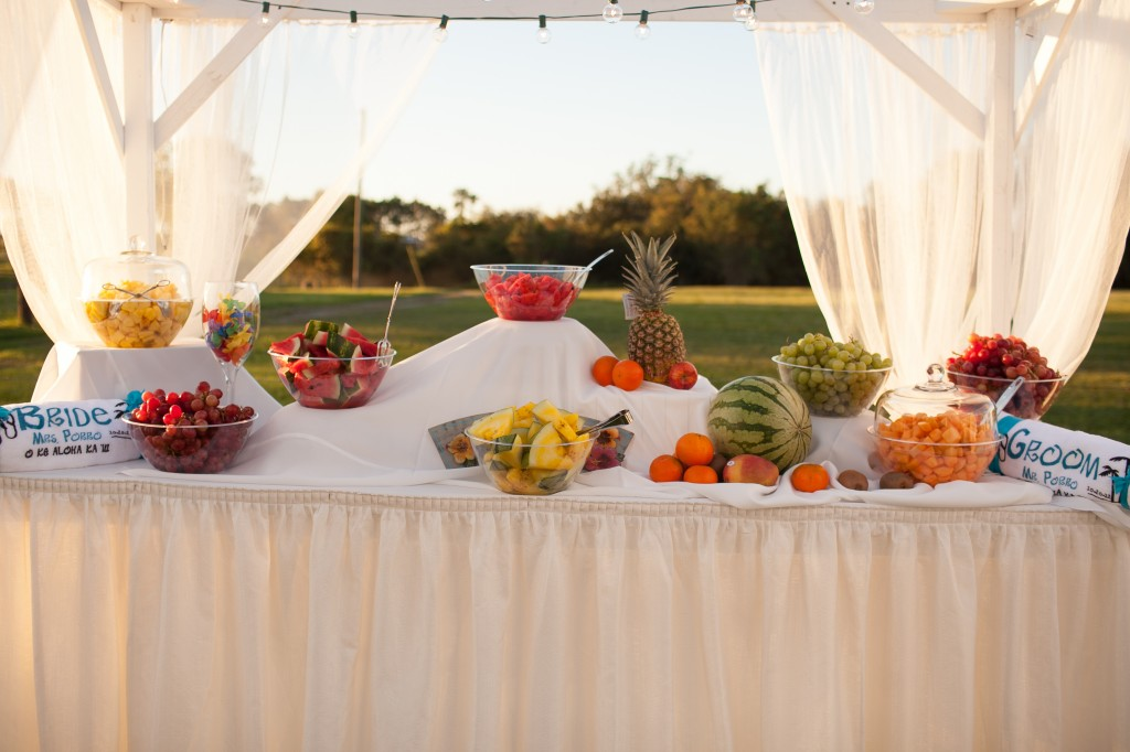 A table with light refreshments such as fruits ensures that your guests are hydrated throughout the day. placing boxes under the table cloth create fun dynamics of different heights.