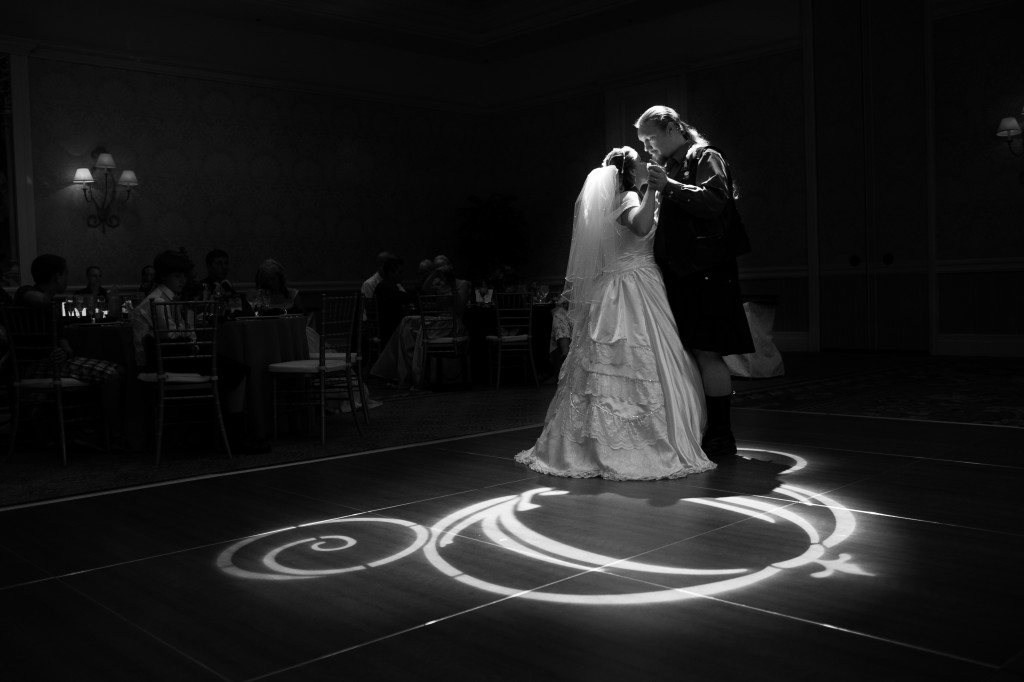 There was hardly any light in the reception room at the Grand Floridian Hotel at this Disney wedding Wedding except for the Disney spotlight directed at the dance floor. This was their first dance and I had to wait a bit until they danced their way directly under the light and this is the result.