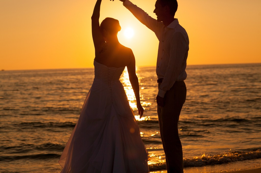 This photograph was taken on Clearwater Beach. I centered the sun directly behind them to create a dark silhouette of them dancing making it more impactfull