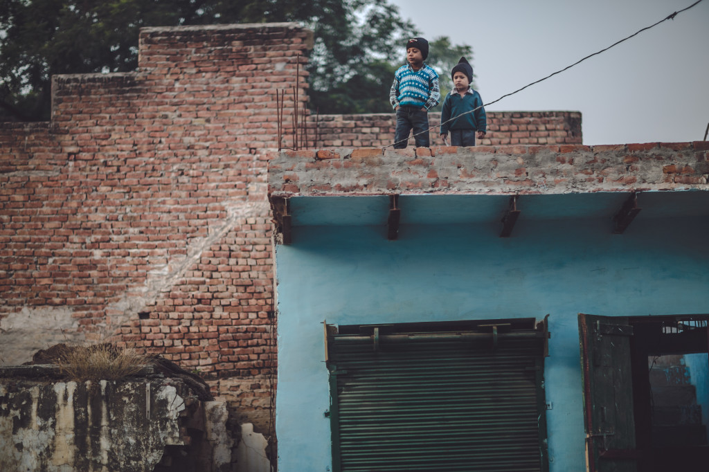 We were wondering how these children got up on the roof, until we saw the stair on the right while editing